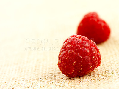 Buy stock photo Macro shot of a few raspberries on a rough table cloth