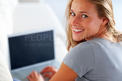 Buy stock photo Closeup portrait of a happy young woman working on laptop