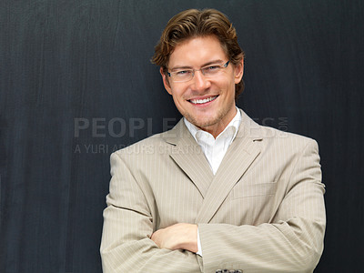 Buy stock photo Portrait of a cheerful businessman smiling against black background
