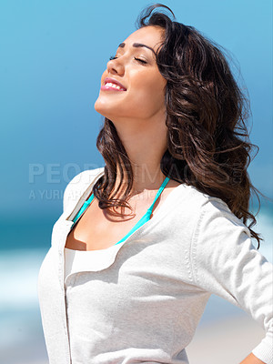 Buy stock photo Close up of a smiling young woman with eyes closed