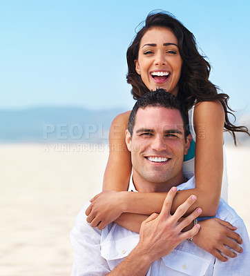 Buy stock photo Portrait of a happy young couple enjoying on beach