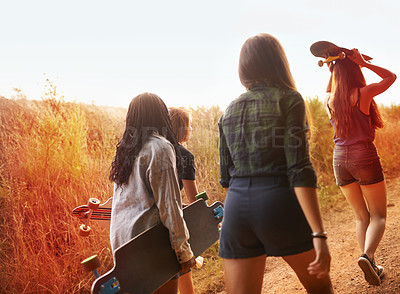 Buy stock photo Four young girls looking for the perfect spot to go skateboarding