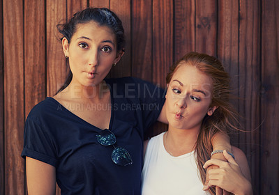 Buy stock photo Two teenage friends making funny faces while spending time together