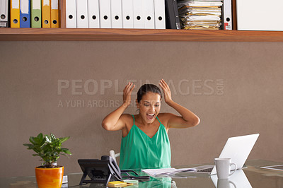 Buy stock photo A woman throwing up her hands in surprise while sitting at her desk