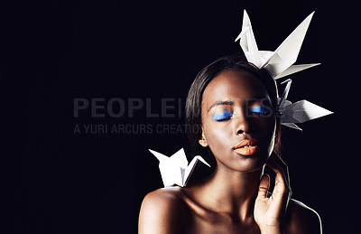Buy stock photo Cropped shot of a beautiful ethnic woman posing with origami birds on her head and shoulders