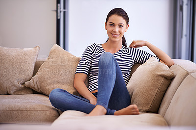 Buy stock photo Portrait of an attractive young woman looking happy and relaxed at home