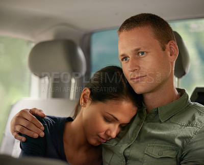 Buy stock photo A beautiful woman falling asleep on her husband's shoulder while travelling