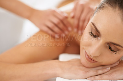 Buy stock photo Cropped shot of a gorgeous young woman enjoying a massage