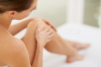 Buy stock photo Cropped shot of a young woman enjoying the feel of her skin