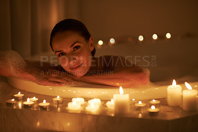 Buy stock photo Cropped shot of a gorgeous woman relaxing in a candle lit bath