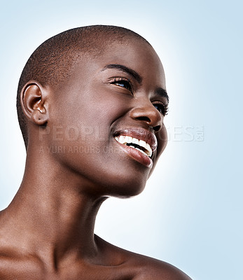 Buy stock photo Low angle shot of a beautiful young african woman on a light blue background