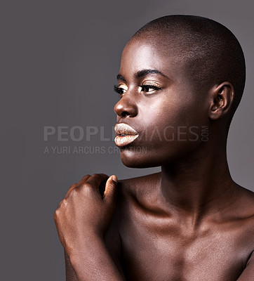 Buy stock photo Cropped shot of a young woman standing in a studio