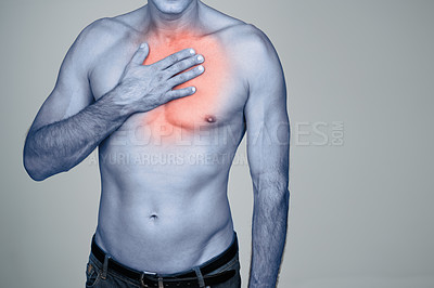 Buy stock photo Studio shot of a mature man rubbing the highlighted injury on his body