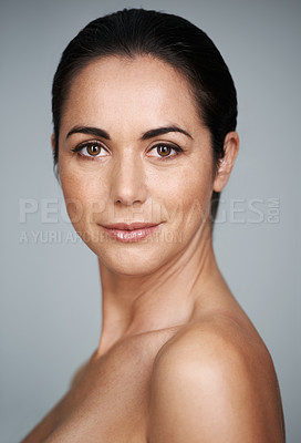 Buy stock photo Studio portrait of a beautiful mid adult woman isolated on a gray background