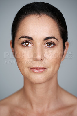 Buy stock photo Cropped studio portrait of a beautiful mature woman against a gray background