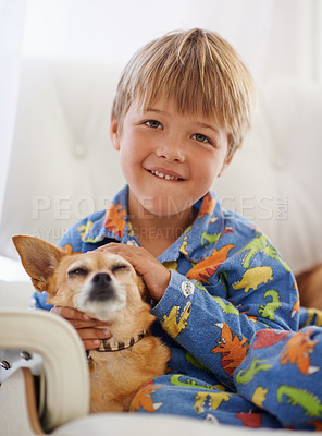 Buy stock photo A cute little boy cuddling his dog on the couch