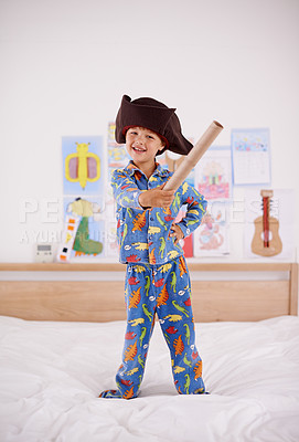 Buy stock photo A little boy playing pirate in his bedroom