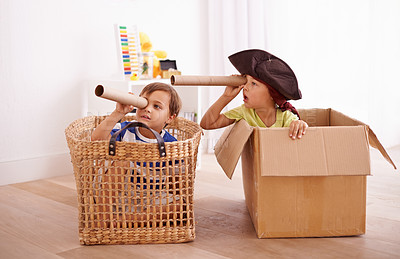 Buy stock photo Shot of two little boys pretending to be pirates in their bedroom