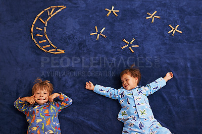 Buy stock photo Two young boys lying underneath a imaginary moon and stars
