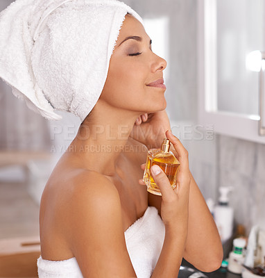 Buy stock photo Cropped shot of a beautiful woman indulging herself with perfume
