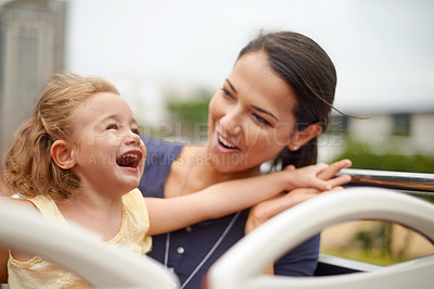 Buy stock photo Shot of a mother watching her daughter while she's having a good time