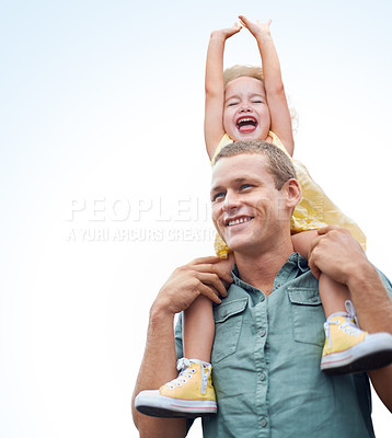 Buy stock photo Shot of a young father carrying his daughter on his  shoulders