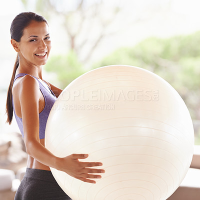 Buy stock photo Portrait of a beautiful young woman holding an exercise ball at home