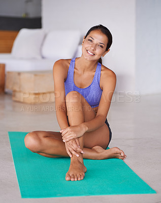 Buy stock photo Portrait of a beautiful young woman sitting on a yoga mat at home