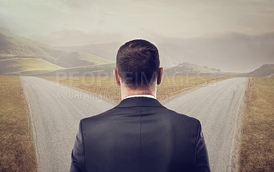 Buy stock photo Rearview shot of a well-dressed man standing at a crossroads - ALL design on this image is created from scratch by Yuri Arcurs' team of professionals for this particular photo shoot