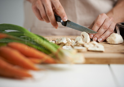 Buy stock photo Closeup shot of a young woman chopping vegetables