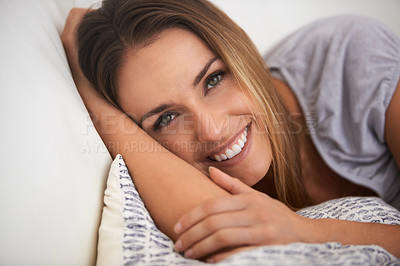 Buy stock photo Close-up shot of a beautiful young woman lying down