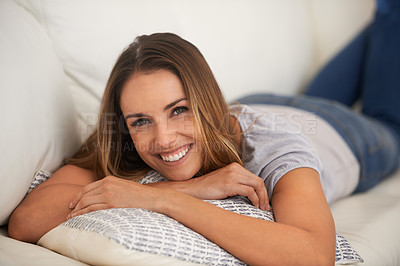 Buy stock photo Cropped shot of a woman lying on her living room sofa