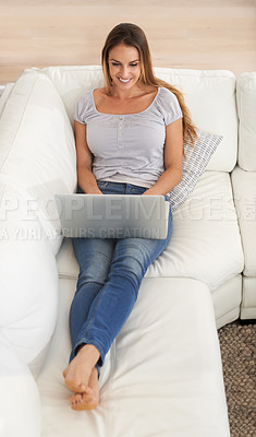Buy stock photo High angle view of a woman sitting with a laptop on her lap