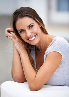 Buy stock photo Portrait of a young woman smiling at the camera