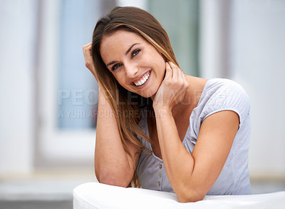 Buy stock photo Portait of a beautiful young woman smiling at camera