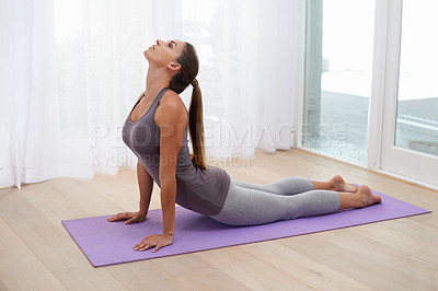 Buy stock photo A young woman doing yoga