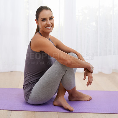 Buy stock photo A beautiful young woman taking a break from her yoga routine