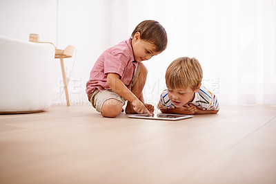 Buy stock photo Shot of little boys playing on the floor