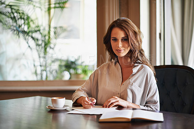 Buy stock photo Portrait of an attractive young woman writing in a relaxed environment at home