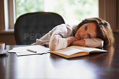 Buy stock photo Portrait of an attractive young woman enjoying a break from writing
