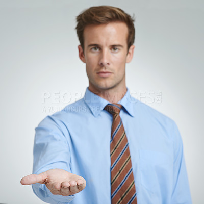 Buy stock photo Studio shot of a businessman with his open palm raised to the camera
