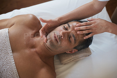 Buy stock photo Shot of a mature man enjoying a relaxing masasage