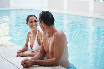 Buy stock photo Cropped shot of a loving mature couple relaxing in a pool