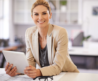 Buy stock photo Portrait of a young blonde businesswoman working on her digital tablet