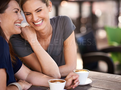 Buy stock photo Cropped shot of two attractive women laughing while drinking coffee