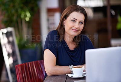 Buy stock photo Portrait of an attractive woman using her laptop at a coffee shop