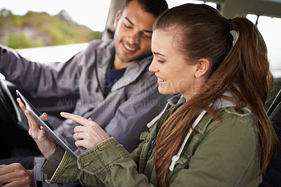 Buy stock photo Cropped shot of a young couple checking their gps while on a roadtrip