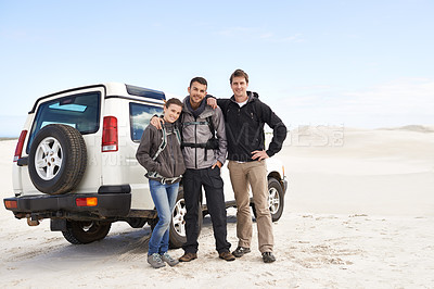 Buy stock photo Shot of a group of friends on a roadtrip