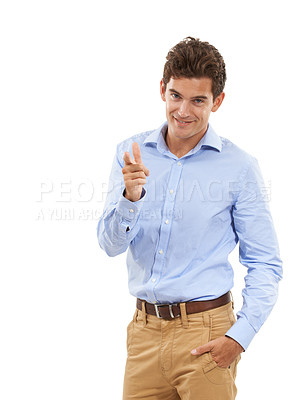 Buy stock photo Portrait of a handsome young man in a studio pointing at the camera