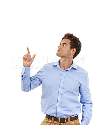 Buy stock photo Shot of a handsome young man in a studio pointing up with one hand